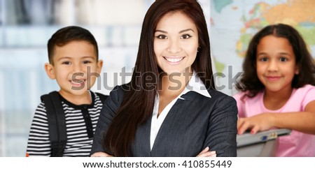 Young teacher with students at their school - stock photo