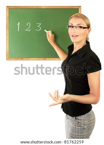 Young teacher writing numbers on the chalkboard, isolated on white background, conceptual image of education - stock photo