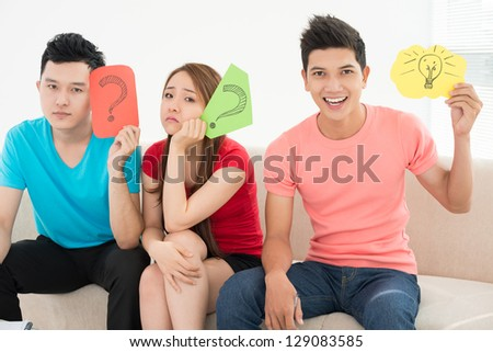 Young team in the thinking process - stock photo
