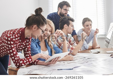 Young team of architects working on a new project - stock photo