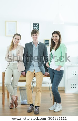 Young team of creative designers standing together - stock photo