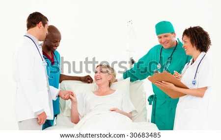 Young team of Doctors attending to a patient - stock photo