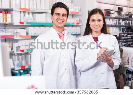 Young team of pharmaceutist and technician working at the chemist shop