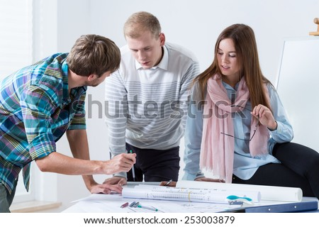 Young team talking about project in the office - stock photo