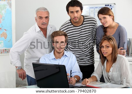 Young team working at a laptop - stock photo