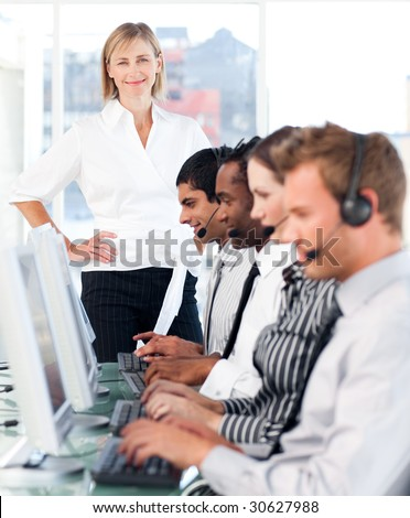 Young Team working in a call centre - stock photo