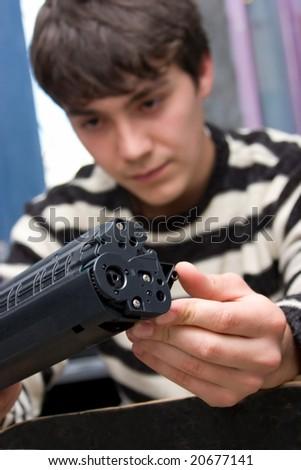 young technician repairing printer - stock photo