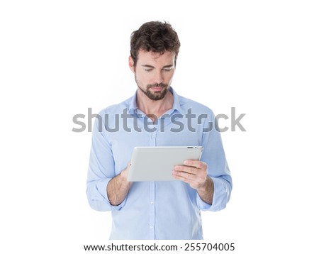 young technological guy absorbed on his screen