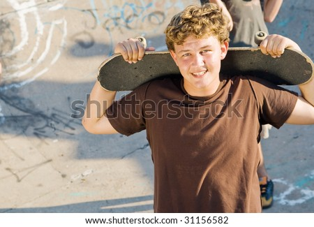 young teen boys together with skateboard on playground - stock photo