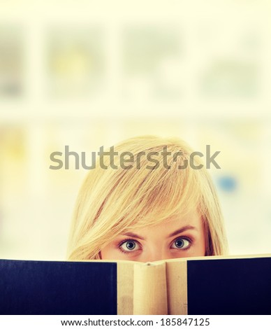 Young teen girl reading a book