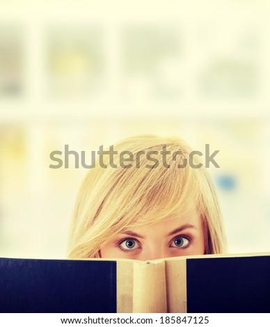 Young teen girl reading a book - stock photo