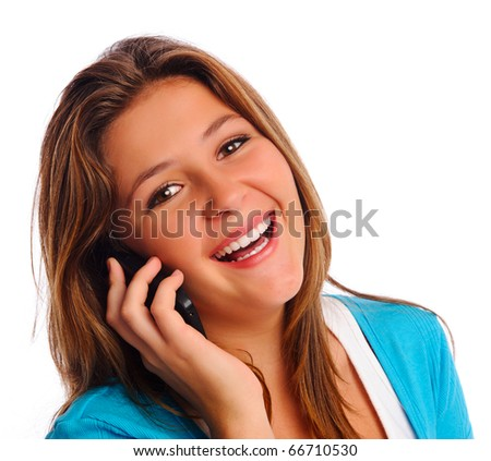 Young teen girl speaking on the phone and looking at camera, isolated on white. - stock photo