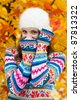 young teen girl wearing colorful sweater in autumn scenery - stock photo
