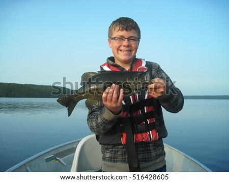 young teen holding a bass