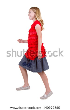 Young teen in the action of stepping up, isolated on white - stock photo