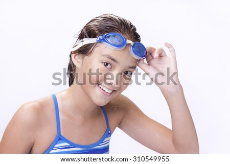 Young teen lifts goggles. - stock photo