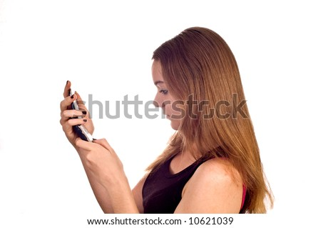 Young teen model with a cell phone, isolated against white