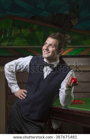 Young teen playing snooker - stock photo