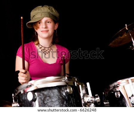 Young teen playing the drums.