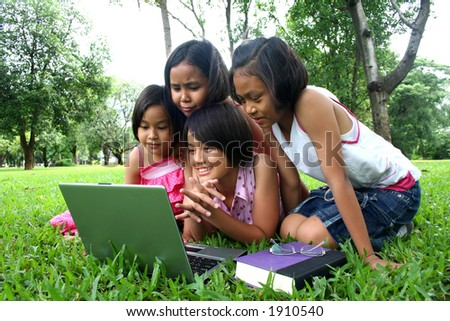 Young teen reading in the park. - stock photo