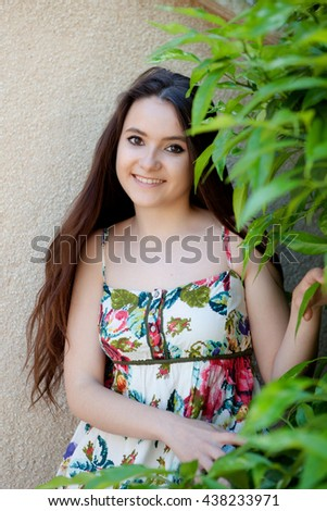 Young teen relaxed outdoors with a natural green background