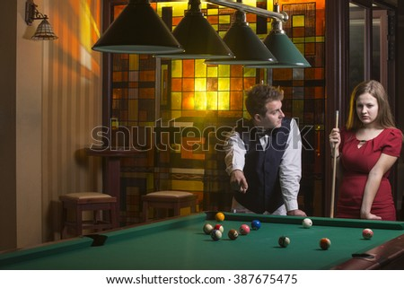 Young teen's playing pool - stock photo