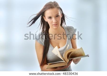 Young teen student woman reading a book. - stock photo