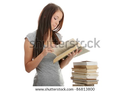 Young teen student woman reading a book, isolated
