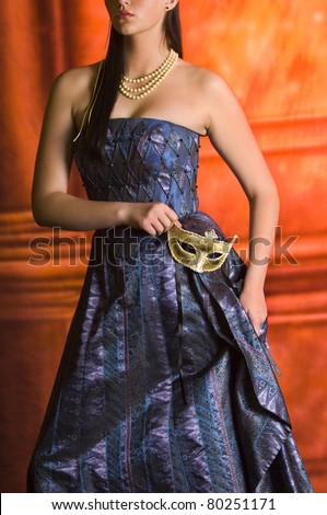Young Teen woman at Masquerade Ball with long dark hair - stock photo