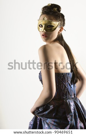 Young Teen woman at Masquerade Ball with long dark hair - stock photo