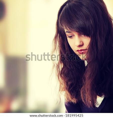 Young teen woman with depression - stock photo