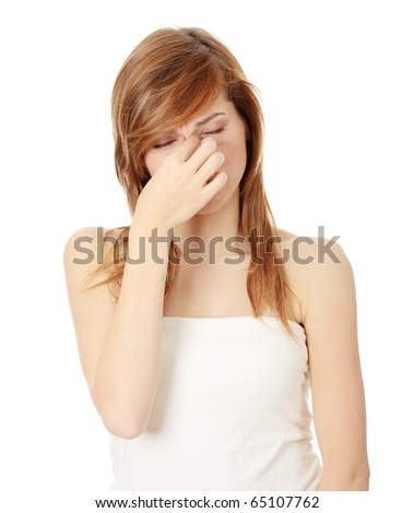 Young teen woman with sinus pressure pain - stock photo