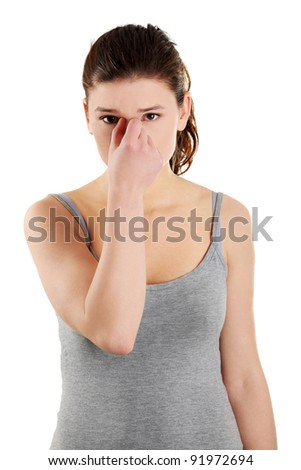 Young teen woman with sinus pressure pain, isolated on white - stock photo