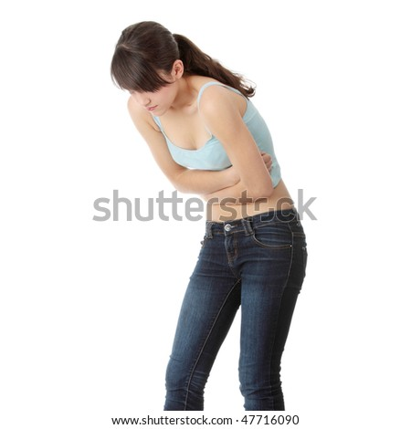 Young teen woman with stomach ache isolated on white background - stock photo
