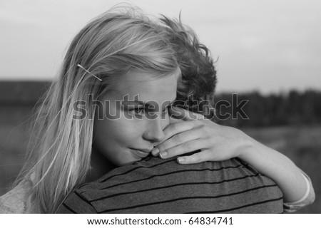 Young teenage couple hugging - stock photo