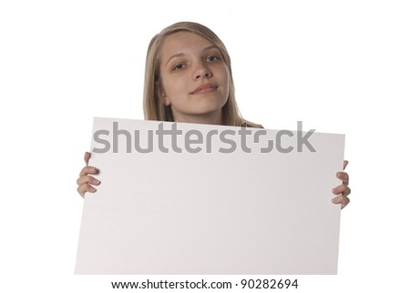 Young teenage girl holding blank sign in front of her. Ready for you text or advertisement.