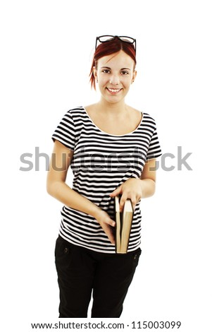 Young teenage girl holding book. Isolated on a white background.