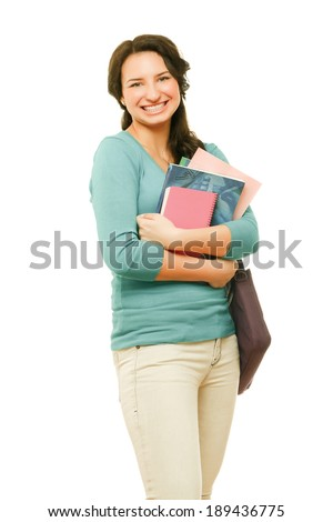 Young teenage girl holding books. Isolated on a white background. - stock photo