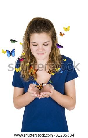 Young teenage girl releasing butterflies - stock photo