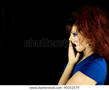 young teenage girl shocked with hand to mouth - stock photo