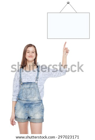 Young teenage girl showing on empty picture frame by finger isolated  - stock photo
