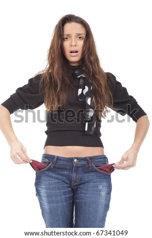 Young teenage girl shows the empty trouser pockets - stock photo