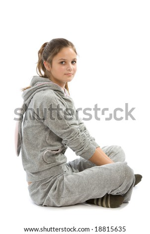 Young teenage girl siting on a floor - stock photo
