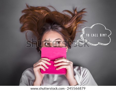 Young teenage girl with cellphone thinking and asking - stock photo