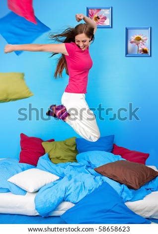 young teenage-woman is in a pillow-fight (my flower photos) - stock photo