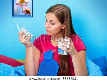 young teenage-woman is sick in bed (my flower photo) - stock photo