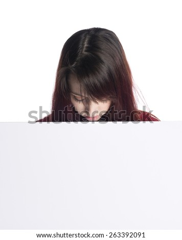 Young Teenage Woman Looking Down at Blank White Board or Sign with Copyspace - stock photo