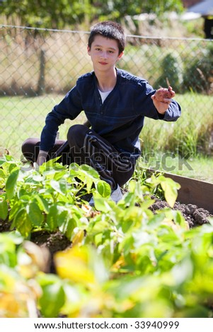 Young teenage working in the garden
