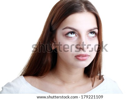 Young teenager acting fed up by rolling her eyes  - stock photo