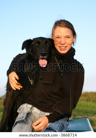young teenager and her black dog